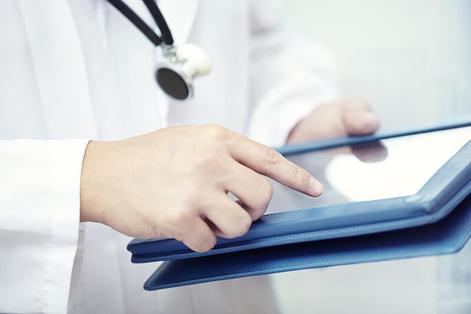 Doctor using tablet HIPAA 24By7Security