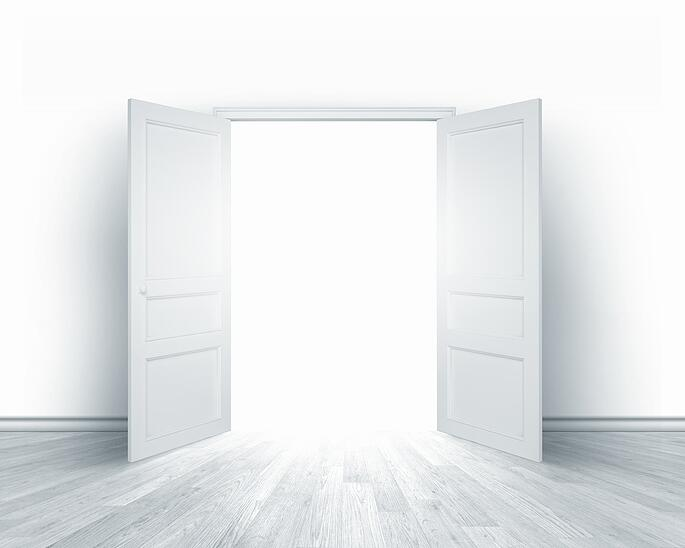 Conceptual image of white opened door. Perspective