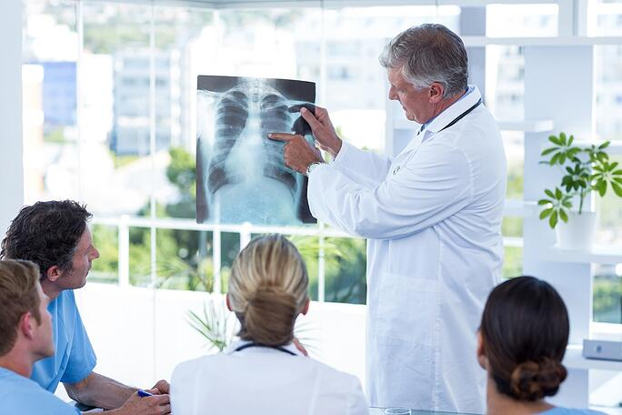 Team of doctors looking at xray in the meeting room