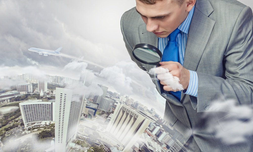 Image of businessman examining objects with magnifier-1