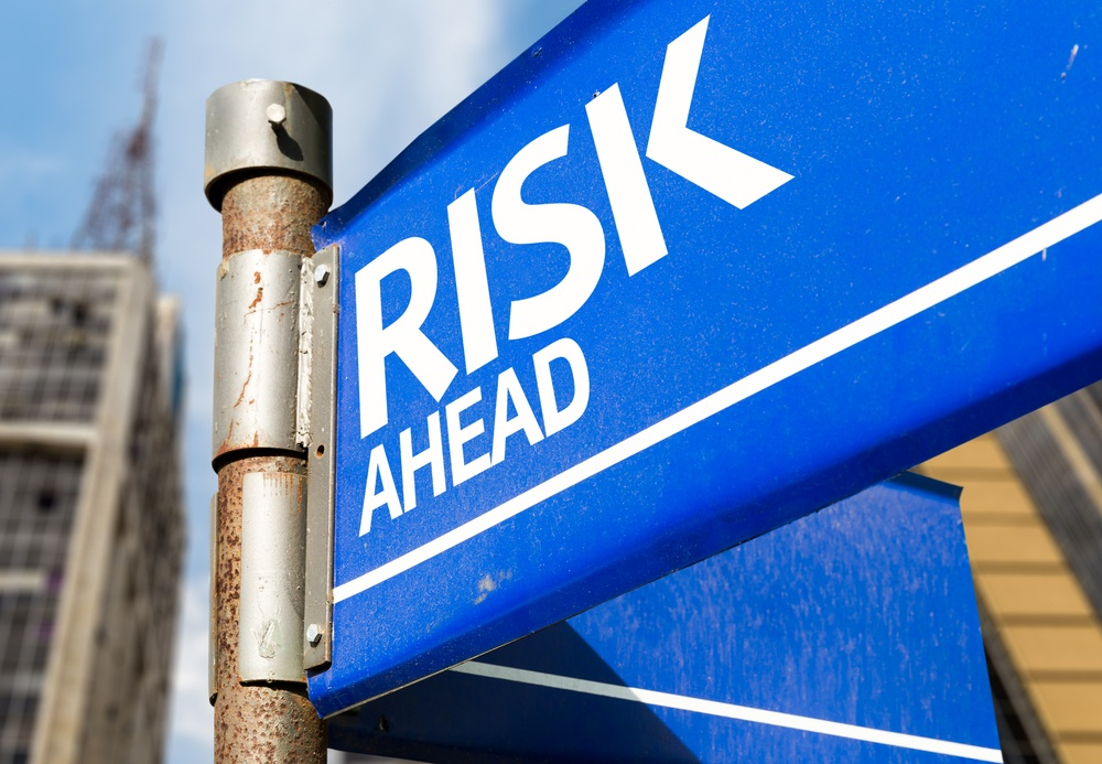 Risk Ahead blue road sign-1